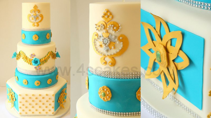 Five tier Ivory and turquoise wedding cake with gold sugar details