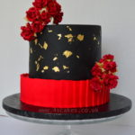 Black and red Wedding cake with gold leaf by London wedding cake makers 4s cakes