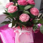 Cup cake bouquet in a posy box with fresh leaves