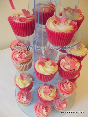 Pink butterfly cup cakes in a tower