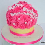 Hot pink giant cup cake by east dulwich cake makers